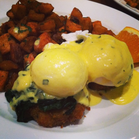 Crab and Crawfish Cakes, Poached Eggs, Spinach, Tarragon Benedict with Home Fries and Caramelized Onions