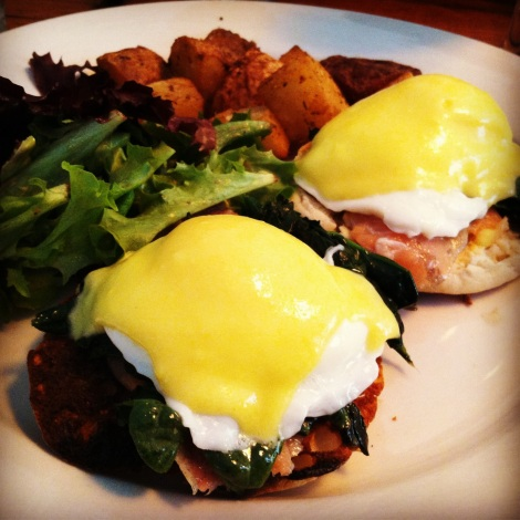 Poached Eggs, Smoked Salmon, Hollandaise Sauce on an English Muffin, Hash Browns and Mesclun Greens