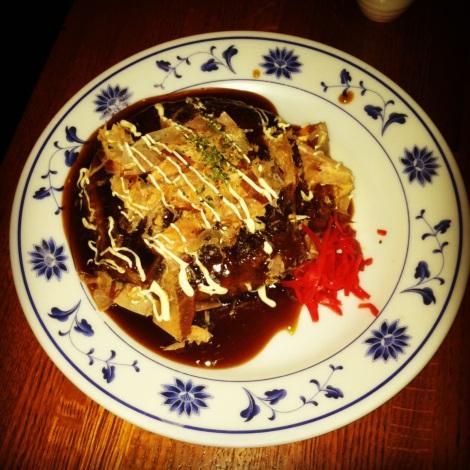 Okonomiyaki – Japanese Pancake with Shrimp, Squid and Scallions, Katsuobushi, Seaweed Flakers, Japanese Mayonnaise, and Okonomiyaki Sauce