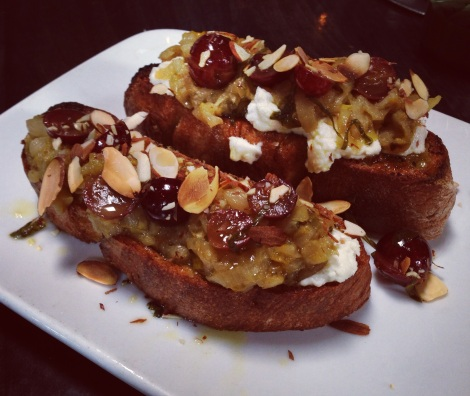 Sourdough Crostini, Warm Goat Cheese, Braised Endive, Spanish Grape Salsa, Almond, Mint