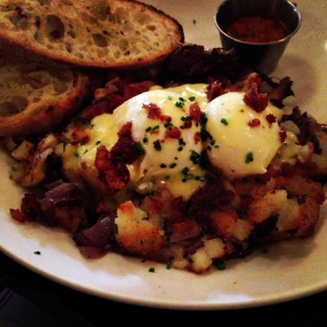 Almond Hash - Duck Confit, Roasted Potatoes, Onions, Duck Cracklin, Poached Egg, Hollandaise, Tomato Salsa, Toast