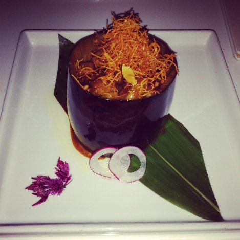 Stuffed Eggplant with Albacore (Tuna), Almonds in a sweet Miso Glaze, served in a Hollow Eggplant.