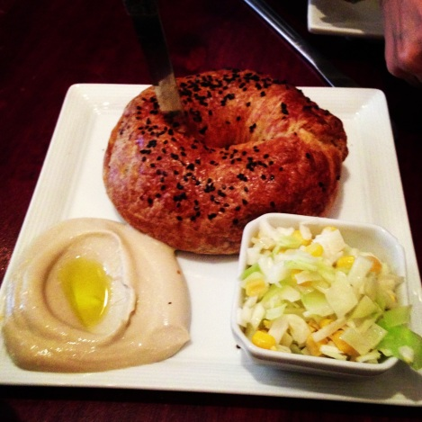 Bureka with Everything Seeds, Goat Cheese, Spinach; Hummus; Corn and Cabbage Salad