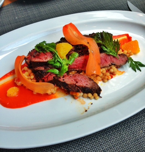 Marrakesh Spiced Flank Steak, Red Pepper Sauce, Pearl Couscous, Shaved Carrots, Cilantro