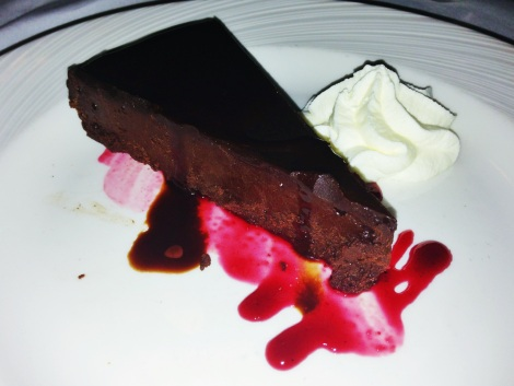 Flourless Chocolate Cake, Raspberry Sauce, Whipped Cream