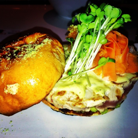 Ahi Tuna Burger, Sprouts, Crushed Avocado, Gingered Carrots, Wasabi Tartar, Potato Bun, Wasabi Flake