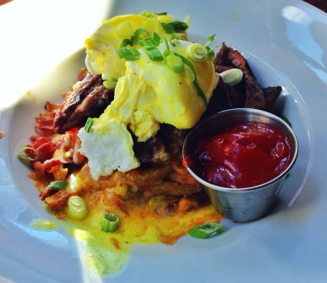 Hangover Fries -- Steak, Homemade Fries, Chopped Tomato, Bacon, Scallion,  Melted Cheddar-Jack, Poached Egg and Cheese Sauce
