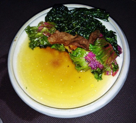 Seared Foie Gras, Cris seared foie comes served with a crisp kale leaf and bathed in a smoked pork hock broth, and even has a stud of smoked pork hock