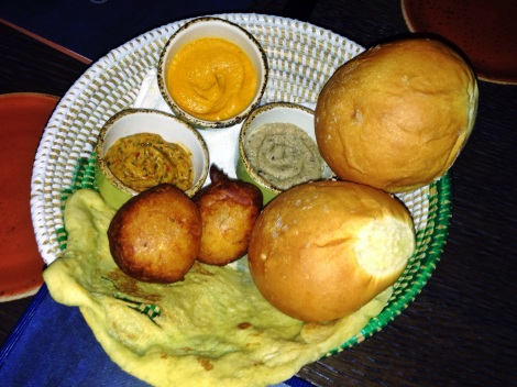 Rolls, Naan, Hushpuppies, Carrot Curry Puree, Black-Eyed Pea Hummus, Roasted Red Pepper and Onion Spread
