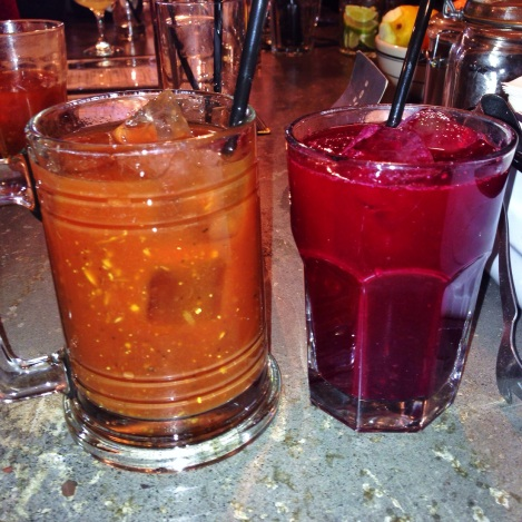 Left: Bourbon, Bacon Bloody Mary Right: Beet Bloody Mary (Apple, Beet, Carrot Juice with Chili infused Vodka)
