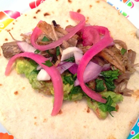 Carnitas Taco, Pickled Onions, Diced Red Onion, and Guacamole