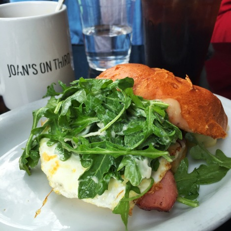 Fried Egg Sandwich, Over Easy Egg, Canadian Bacon, Jack Cheese, Arugula, Garlic Aioli on a Toasted Brioche Bun