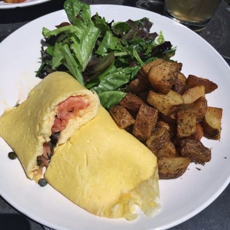 Soft Scrambled Omelettes Smoked Salmon, Chive Crème Fraîche & Capers, Roasted Potatoes and Mesclun Greens at Rabbithole in Brooklyn