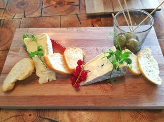 White & Blue Cheese Platter with Olives, Red Currant Jam and Garlic Bread Crisps